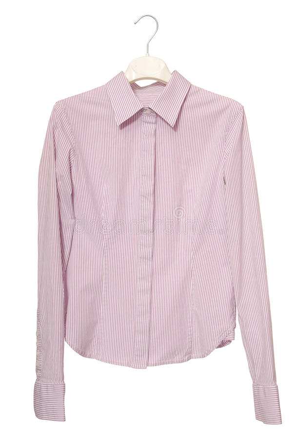 Stripy blouse is on hanger. stock images