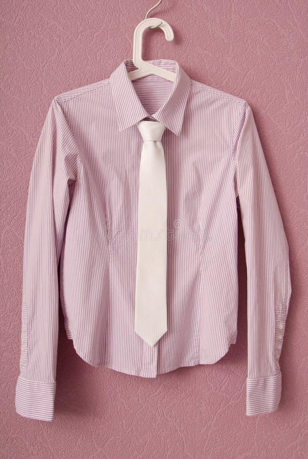 Stripy blouse is on hanger. stock image