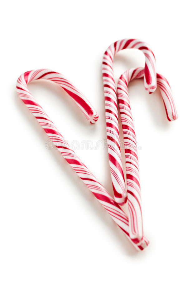 Stripy candy cane. On white background royalty free stock photos