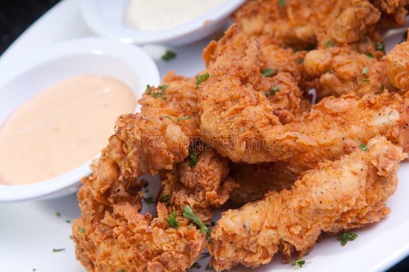 Strisce fritte e impanate del pollo fotografia stock libera da diritti