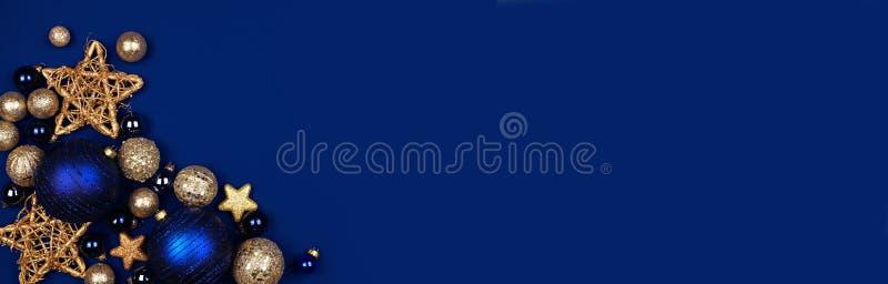 Striscione di bordo blu scuro e dorato, sopra uno sfondo blu di mezzanotte fotografia stock libera da diritti