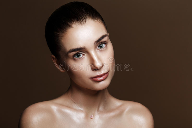 Strobing or Highlighting makeup. Closeup portrait of beautiful g royalty free stock photo