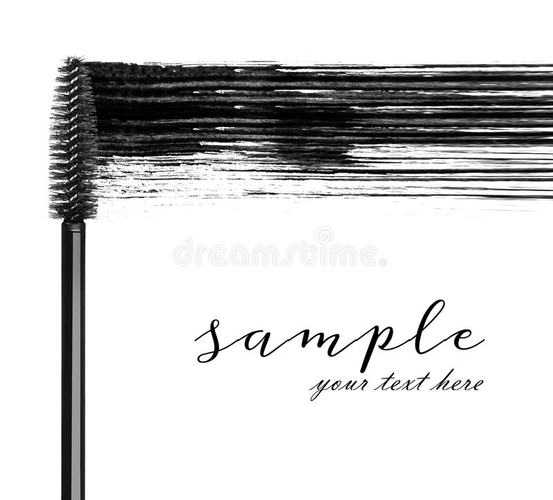 Stroke of black mascara with applicator brush close-up.  stock image