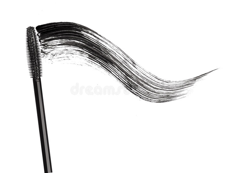 Stroke of black mascara with applicator brush close-up. Isolated on white background royalty free stock photos