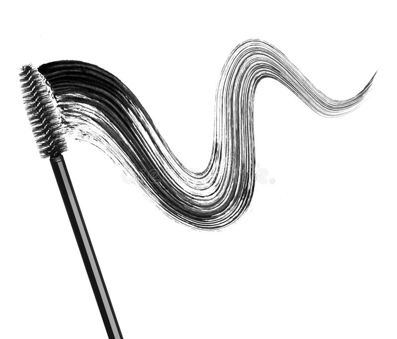 Stroke of black mascara with applicator brush close-up. Isolated on white background stock photography