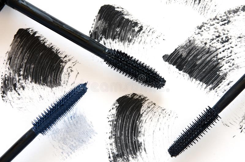 Stroke of black mascara with applicator brush close-up, isolated on white background. Image stock photos