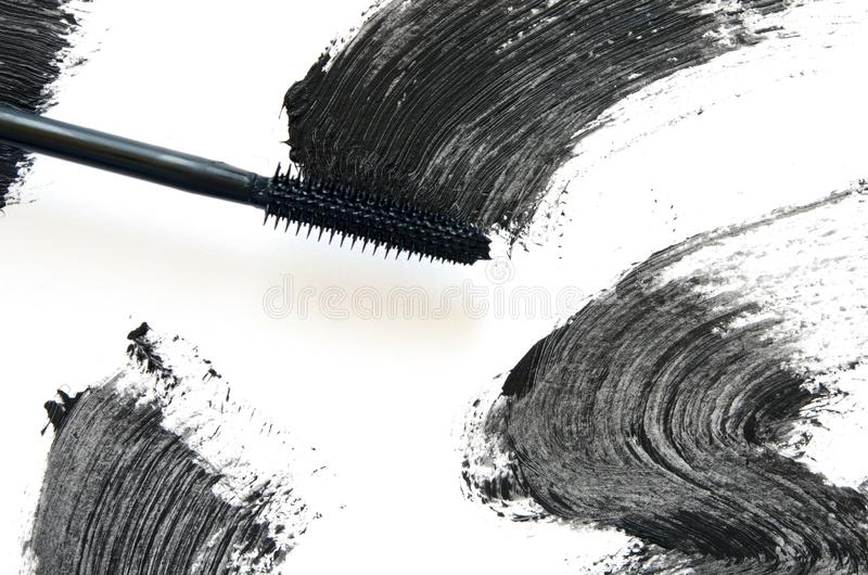 Stroke of black mascara with applicator brush close-up, isolated on white background. Image royalty free stock image