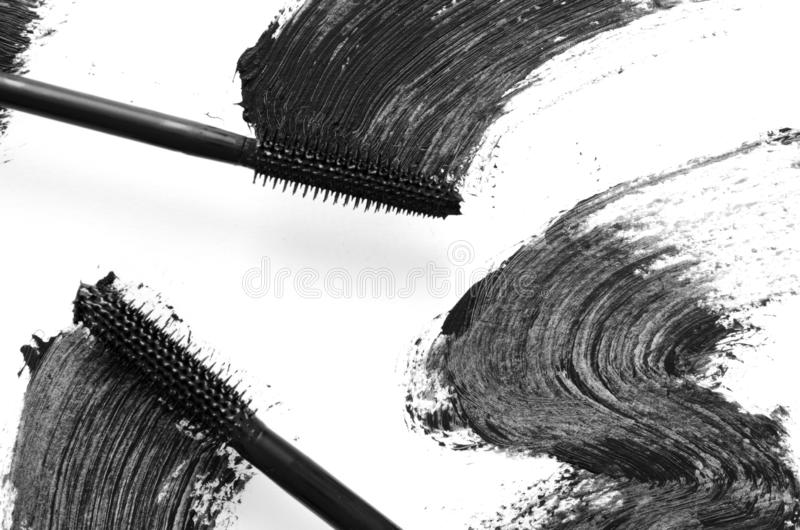 Stroke of black mascara with applicator brush close-up, isolated on white background. Image stock photo