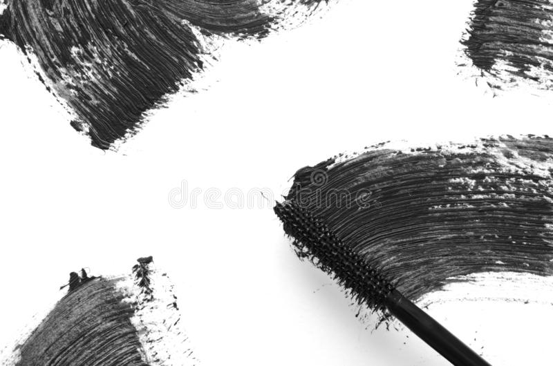 Stroke of black mascara with applicator brush close-up, isolated on white background. royalty free stock photography