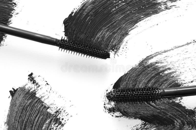 Stroke of black mascara with applicator brush close-up, isolated on white background. stock photography