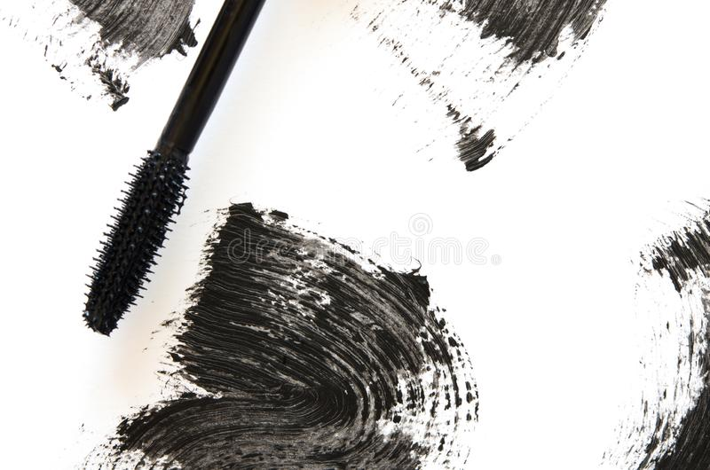 Stroke of black mascara with applicator brush close-up, isolated on white background. Image royalty free stock photography