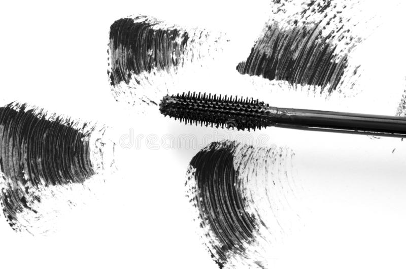 Stroke of black mascara with applicator brush close-up, isolated on white background. Image stock photography