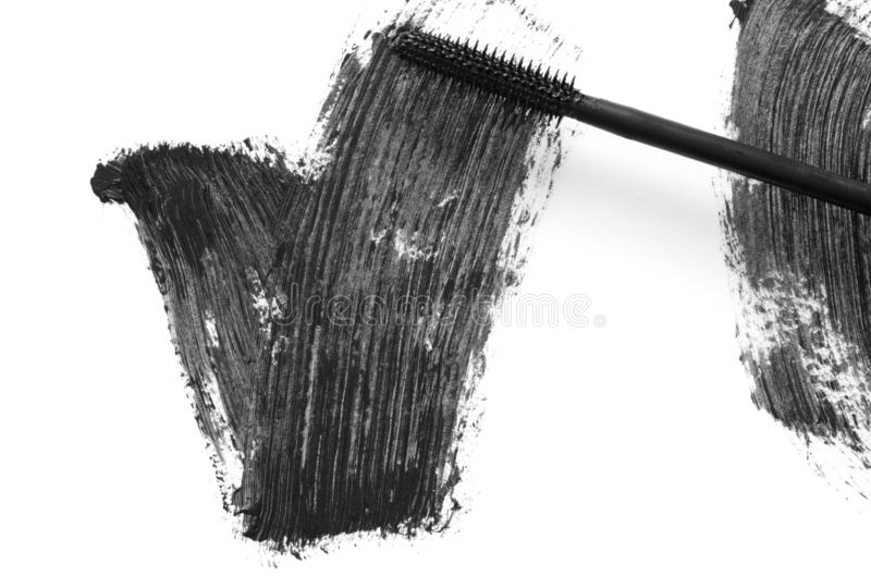 Stroke of black mascara with applicator brush close-up, isolated on white background. Image stock image