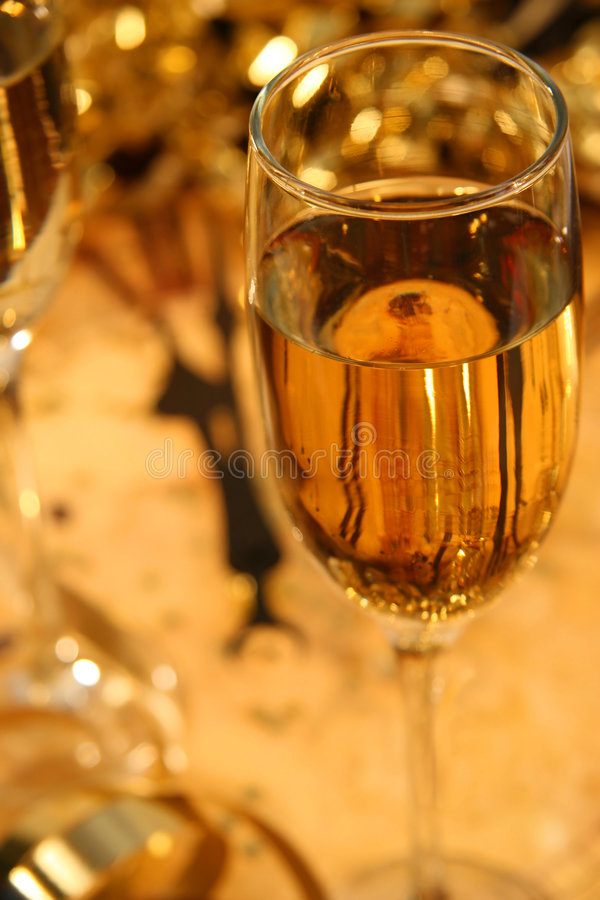 Stroke of midnight. Countdown to midnight with champagne/ Conceptual idea New Years Eve midnight royalty free stock photo