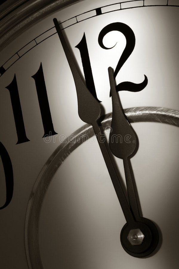 Download Stroke Of Midnight On A Clock In Dramatic Light Stock Image - Image: 7329837