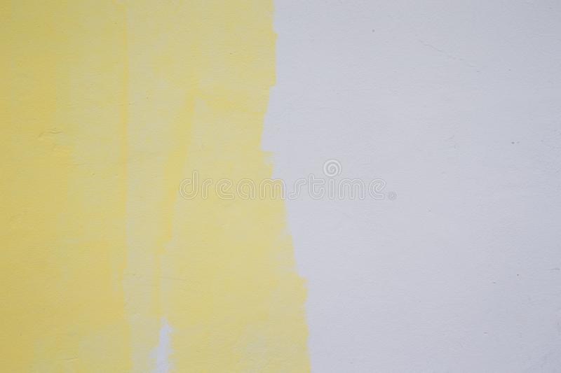 Yellow Paint Roller On White Wall Stock Image - Image of tool, white ...