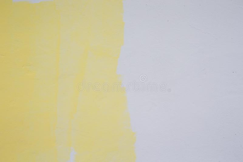 Yellow Paint Roller On White Wall Stock Image - Image of painter ...