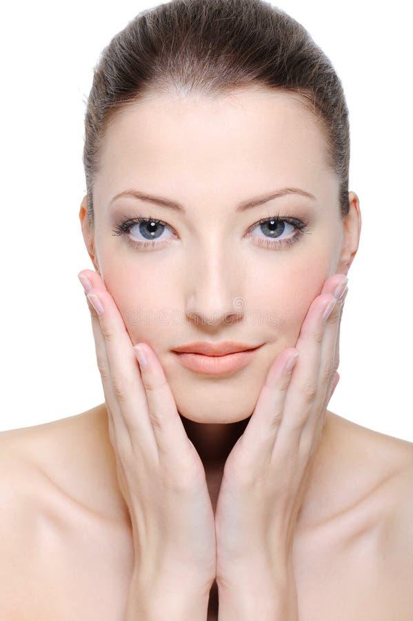 Stroking face skin royalty free stock image