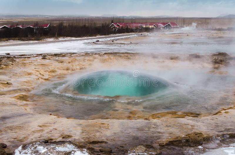 The eruption of the Strokkur geyser in the southwestern part of Iceland in a geothermal area near the river Hvitau stock images