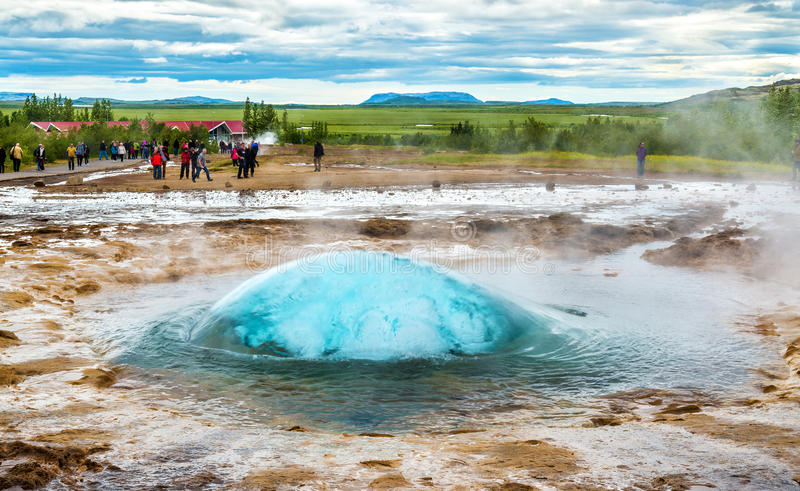 Strokkur geyser about to erupt. View of Strokkur geyser about to erupt - Iceland stock images