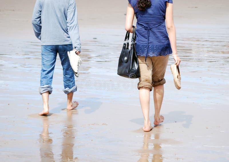 Stroll on the beach royalty free stock photos