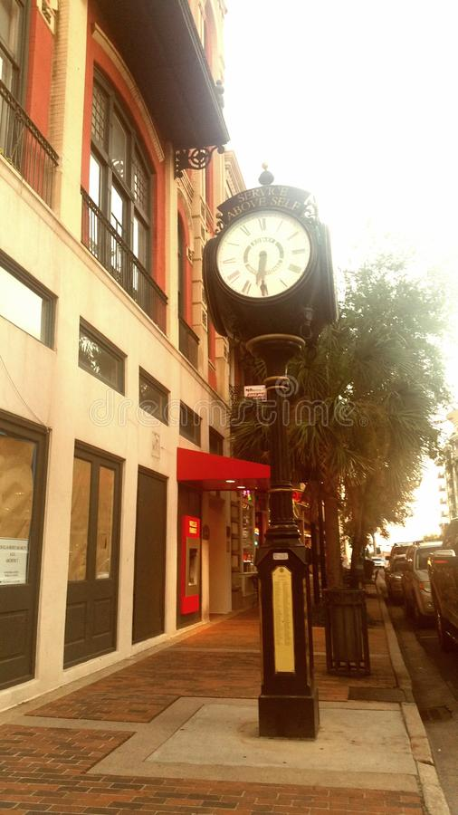 A Stroll on the Boulevard. Downtown Mobile, Alabama is a vibrant mix of Southern charm and contemporary hospitality. Older structures such as this clock statue stock photography