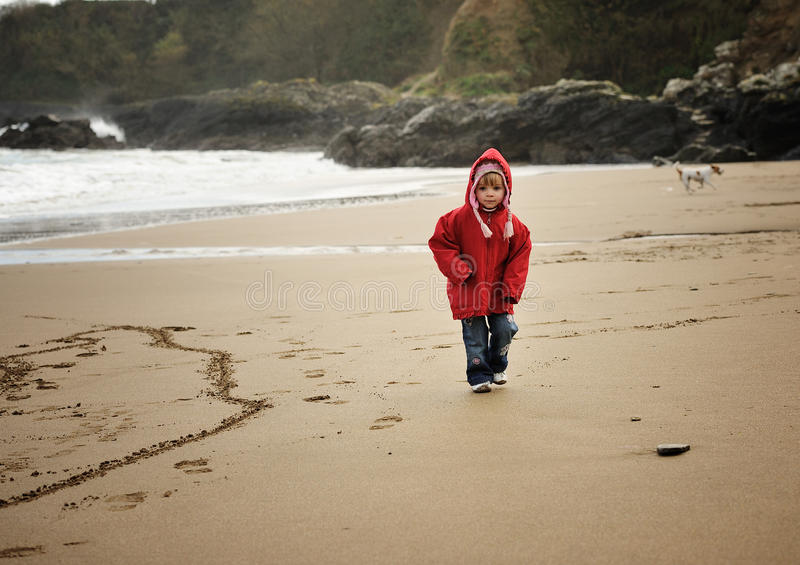 Strolling on the Beach. A little girl strolling on a beach royalty free stock photography