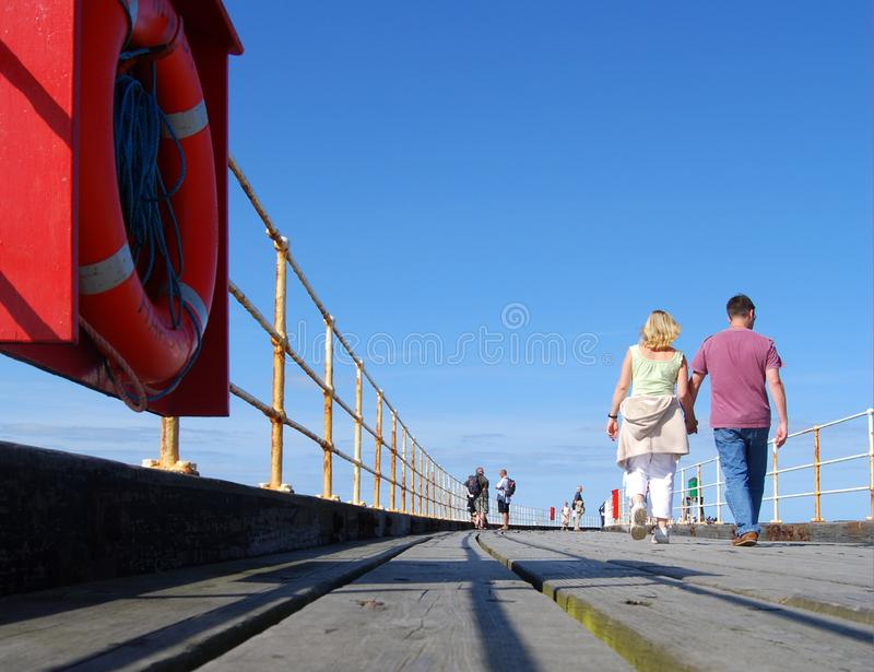 Strolling on Whitby pier stock photos