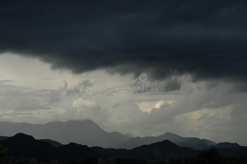 Strom and big black cloud over mountain. Monsoon period royalty free stock photos