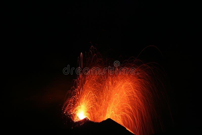 Stromboli erupts at night. A nighttime eruption of the mountain Stromboli stock photography