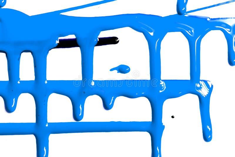 Stromen van blauwe verf stock foto's