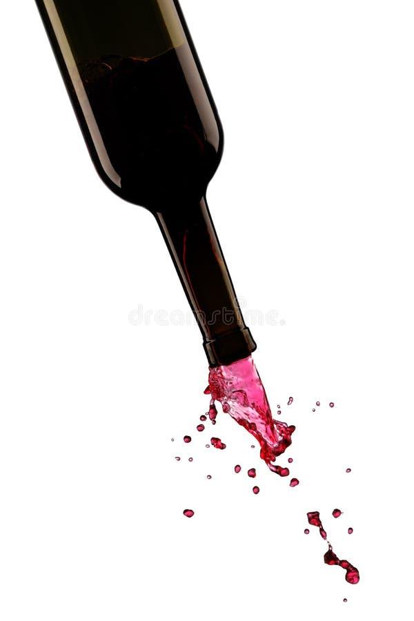 Stromende wijn van een fles stock fotografie