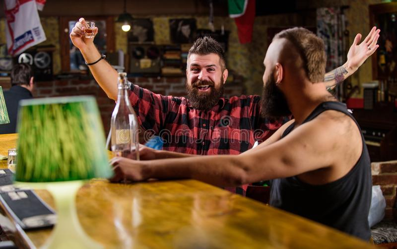 Strong alcohol drinks. Alcohol addiction. Friends relaxing in pub. Men drunk relaxing at pub having fun. Hipster brutal royalty free stock photo