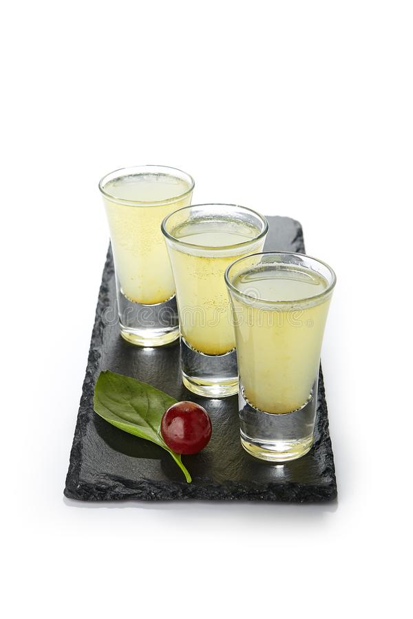 Strong Alcohol Shot Set in Three Small Glasses Isolated royalty free stock photo