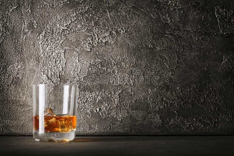 Strong alcoholic drink scotch whisky with ice cube in old fashion glass royalty free stock photos