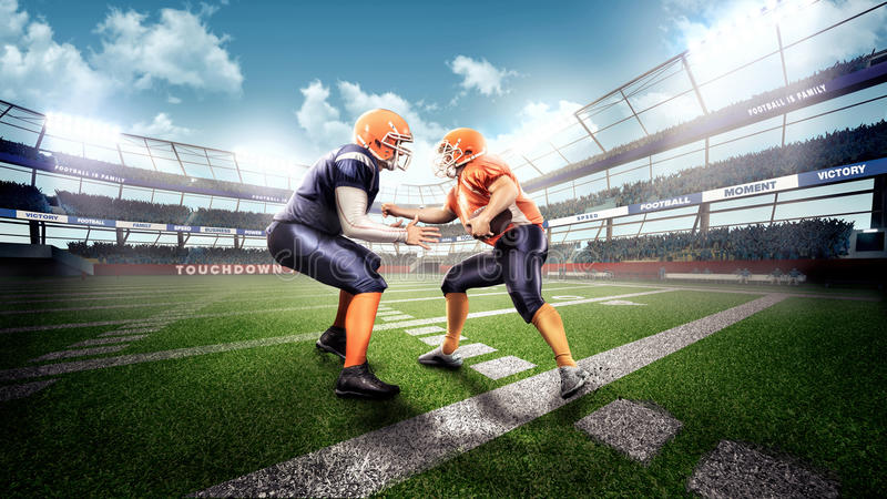 Strong american football players in the action stock photography