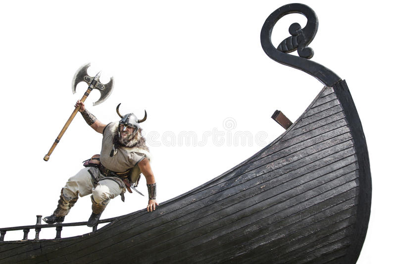 Strong angry bearded Viking with axe jumping stock image