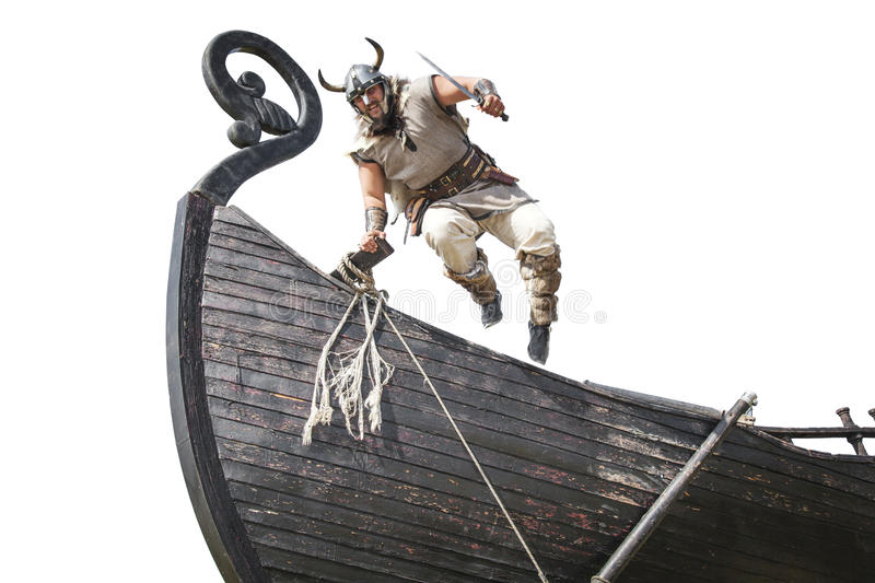 Strong angry bearded Viking with knife jumping royalty free stock photography