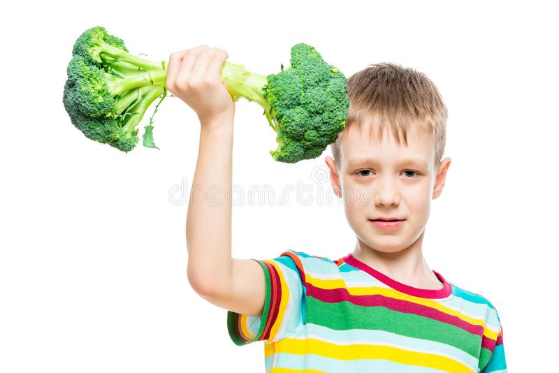 Strong athlete training in weight lifting on broccoli, portrait isolated concept. Photo stock images