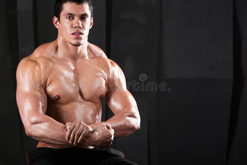 Strong athletic man on black. royalty free stock images