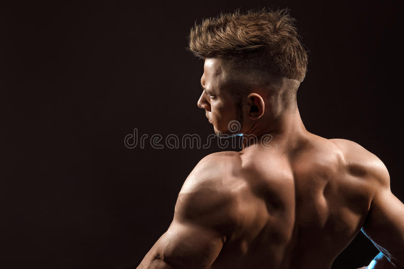 Strong Athletic Man Fitness Model posing back muscles. stock photo