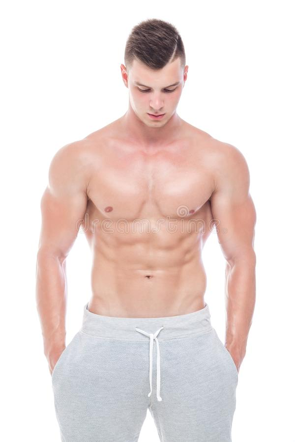 Strong Athletic Man - Fitness Model showing his perfect body isolated on white background with copyspace. Bodybuilder. Man with perfect abs, shoulders,biceps royalty free stock photo