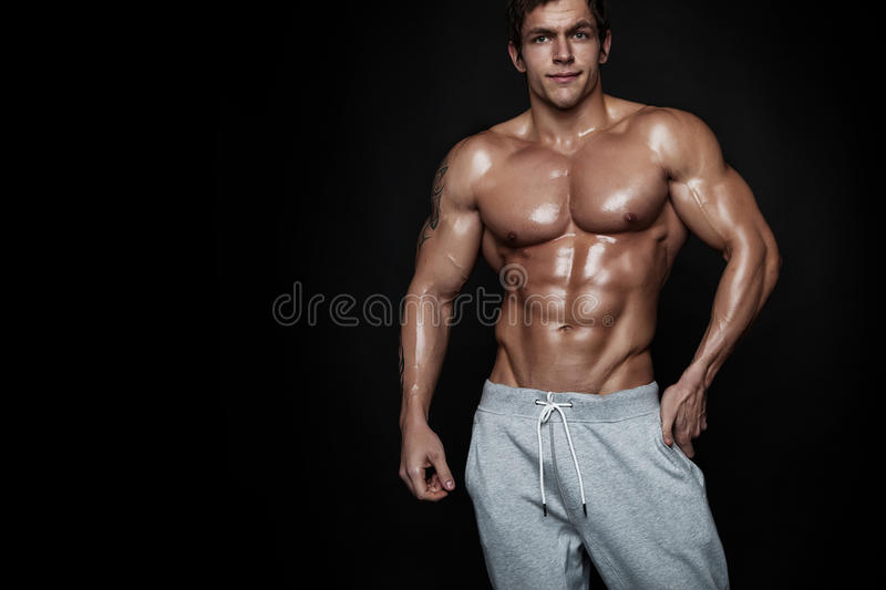 Strong Athletic Man Fitness Model Torso showing muscles stock images