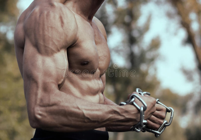 Strong Athletic Man Fitness Model Torso showing. Muscular guy. Fitness Model royalty free stock image