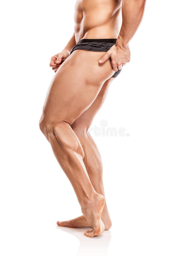 Strong Athletic Man Fitness Model Torso showing naked muscular b. Ody and legs isolated on white background royalty free stock image
