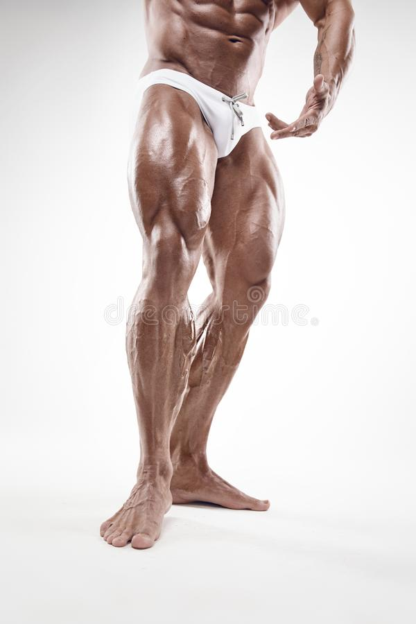 Strong Athletic Man Fitness Model Torso showing naked muscular b. Ody and legs isolated on white background royalty free stock photos