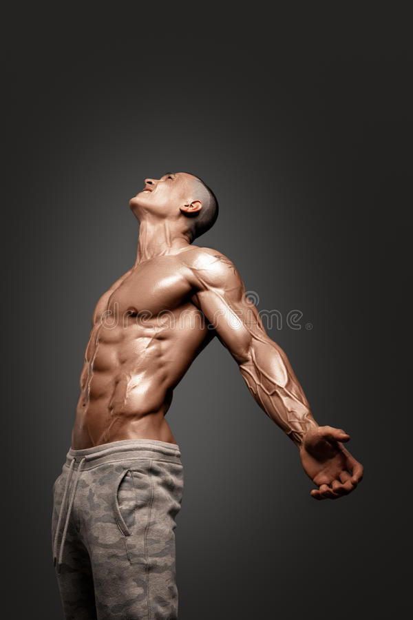 Strong Athletic Man Fitness Model Torso showing six pack abs. Isolated on black background with clipping path royalty free stock photography