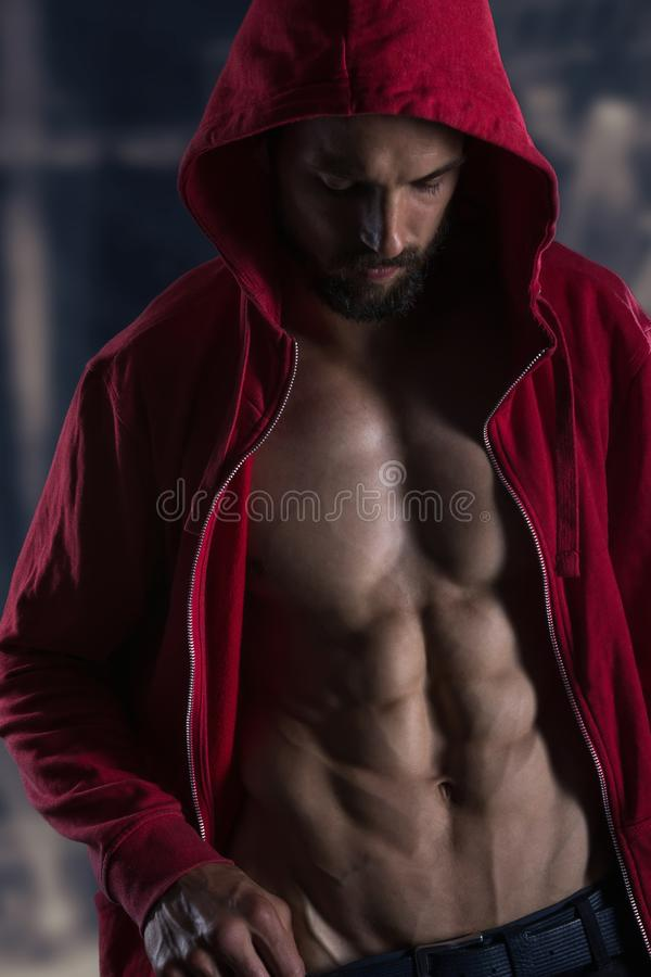 Strong Athletic Man Fitness Model Torso showing six pack abs. Fitness Model royalty free stock photos