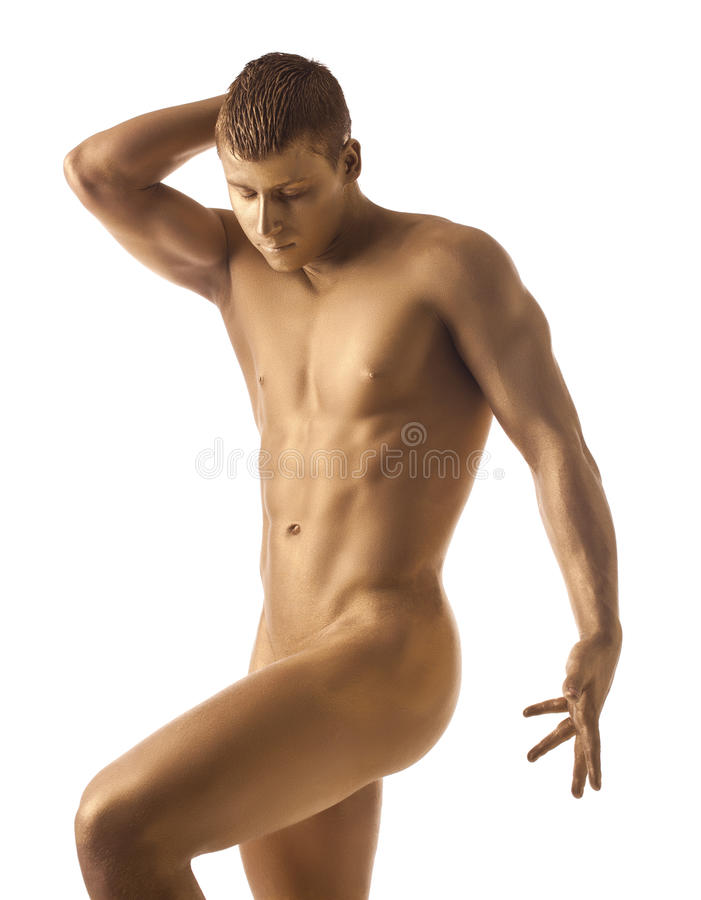 Strong athletic man posing nude with gold skin. Athletic man posing naked in dark with gold skin isolated royalty free stock images