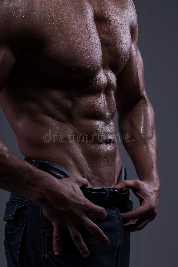 Strong athletic man torso stock images